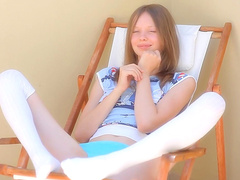 Cutie Gloria is lying on the chair naked