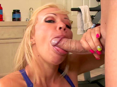 Blonde pornstar dressed in leggings bends over to suck cock