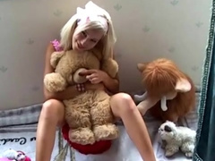 Adorable teen with tan lines plays with her teddy bear