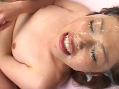 Innocent Asian babe is getting cum over her face