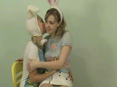 Amber is playing with her sister bunny
