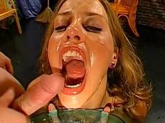 cock-swallowing lady smiles during bukkake