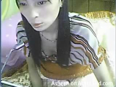 Amateur Asian with toy in vagina