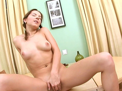 Anina is fingering her shaved pussy so sweet