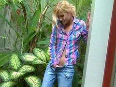 Sasha undresses very nice in the garden