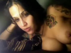 Busty amateur with dark hair and tatts rubs her twat