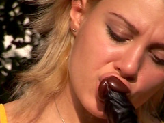 Britt C is sucking that big black dildo