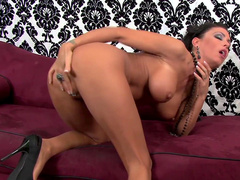 Fake-tit brunette Jessica Jaymes poses naked