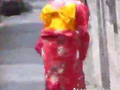 Japanese girls in kimonos outdoors
