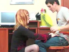Mature redhead sits on him