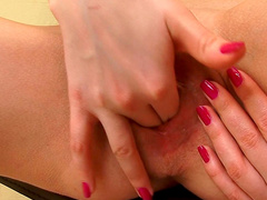 Blonde Logan Bella masturbates her puss on the chair