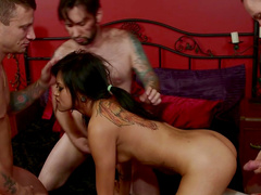 Sexy tattooed Asian fucks with two big poles