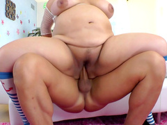 Fat Asian Kelly Shibari is sucking a pole