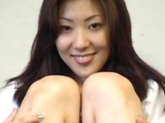 Asian cutie is demonstrating her long legs