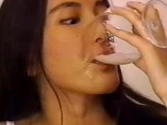 Japanese slut swallows cum from a glass