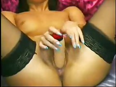 Sexy girl with small tits uses a dildo for masterbating