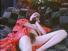 Brunette vintage babe with a hairy pussy in porn clip