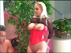 Large boobed golden-haired honey screwed in boots and corset