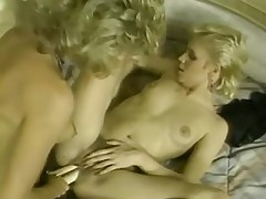 A couple of horny blonde retro lesbians have some fun