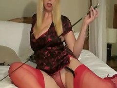British bitch Lucy G plays with a riding crop