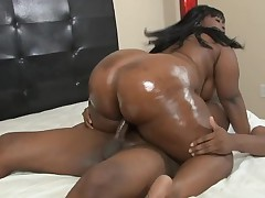 2 ebon strumpets take turns giving hung dark lad a great blow job