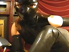 Gal in latex mask on cam