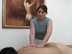 Topless massage receives client off