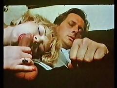 Blonde sucks and fucks a big cock in a classic video