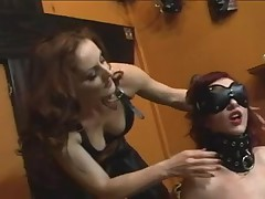 Cute redhead receives dominated by redhead in darksome leather