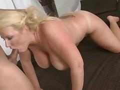 Aged blond slut engulfing penis