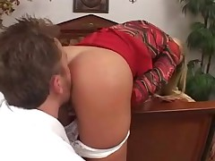 Blonde MILF gets a messy facial by a hot young cock