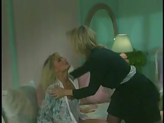 Golden haired retro lesbians have fun with one another