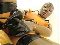 Angel in rubber masturbates