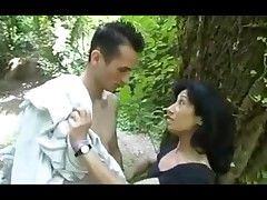 Brunette MILF fucking in the woods totally naked