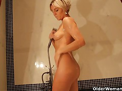 Hawt older mamma takes a bathroom and masturbates with vibrator