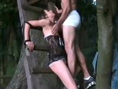 Sexy girlfriend tied to a tree