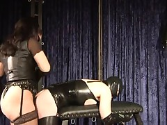 rubber thrall is happily screwed in the arse by Dominatrix Silvia
