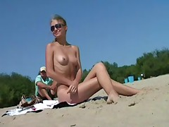 Nudist angels have pleasure with every other at the beach