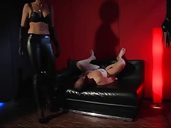 Spandex redhead receives cunnilingus in latex sex video