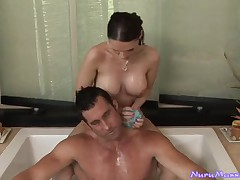 Breasty honey sucks on a biggest dong in the jacuzzi