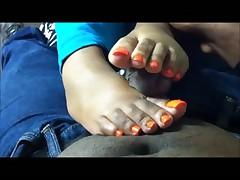 Orange toes footjob
