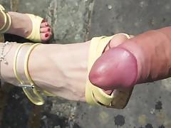 Jerking off on a pair of feet in high heels