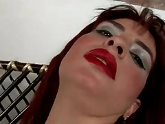 Obese redhead with petite breasts in act