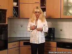 Blond granny bonks herself on the kitchen floor