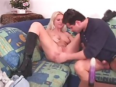 Cute blonde in boots fucked with a dick and a dildo