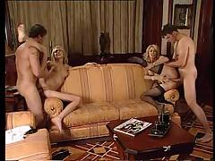 Two Slutty MILFs enjoying a foursome fucking experience
