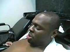 Ebony hairdresser blows her customer