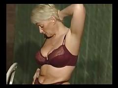 Blonde mature sweetie stripping and masturbating