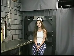Cute juvenile brunette hair with tattoo is restrained by Dom Len in dungeon