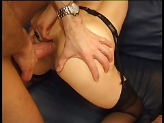 Brunette with pantyhose receives a double pussy fuck